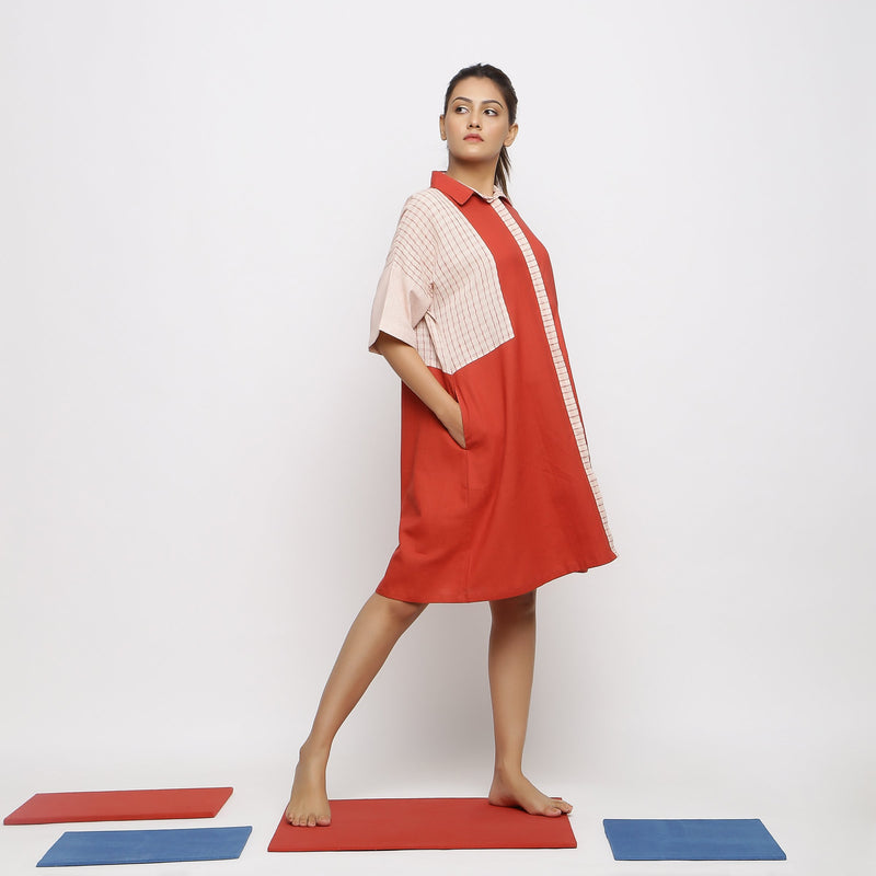 Right View of a Model wearing Brick Red Vegetable Dyed Button-Down Dress