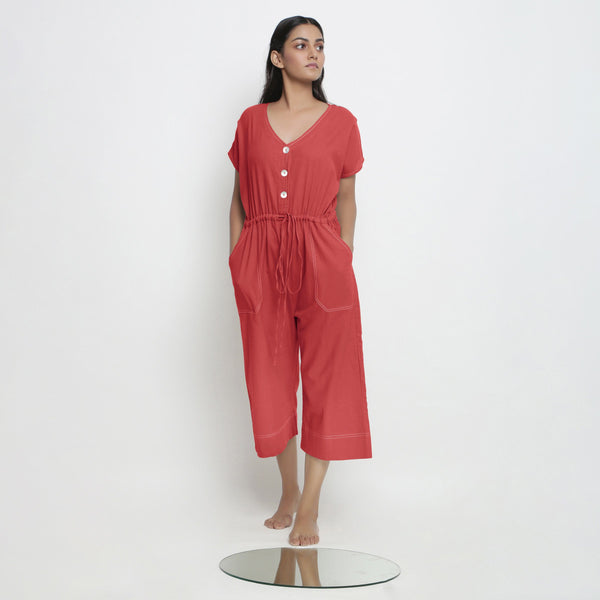Front View of a Model wearing Brick Red Vegetable Dyed Button-Down Jumpsuit