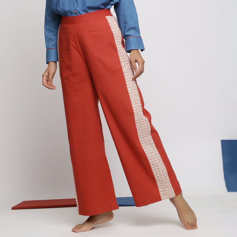 Left View of a Model wearing Brick Red Vegetable Dyed Wide Legged Pant