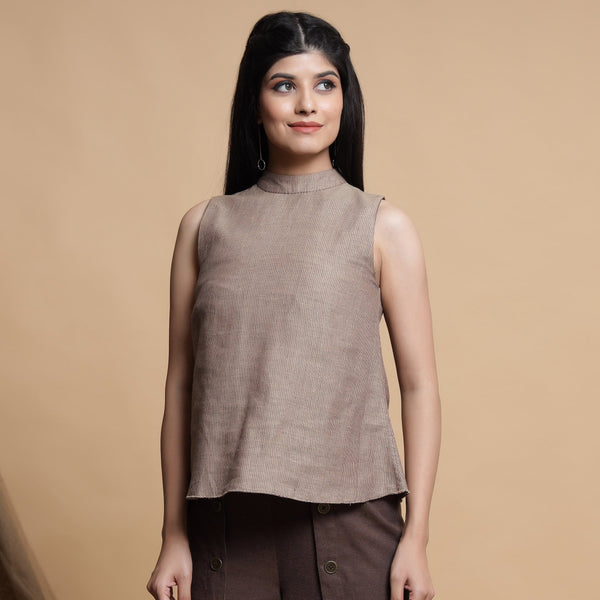 Front View of a Model wearing Brown and Beige Reversible Yoke A-Line Top