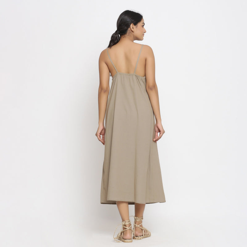Back View of a Model wearing Brown Cotton Flax Strap Sleeve A-Line Dress