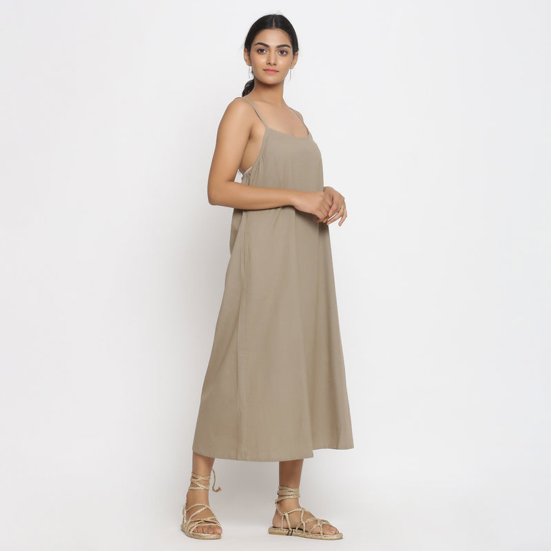 Right View of a Model wearing Brown Cotton Flax Strap Sleeve A-Line Dress