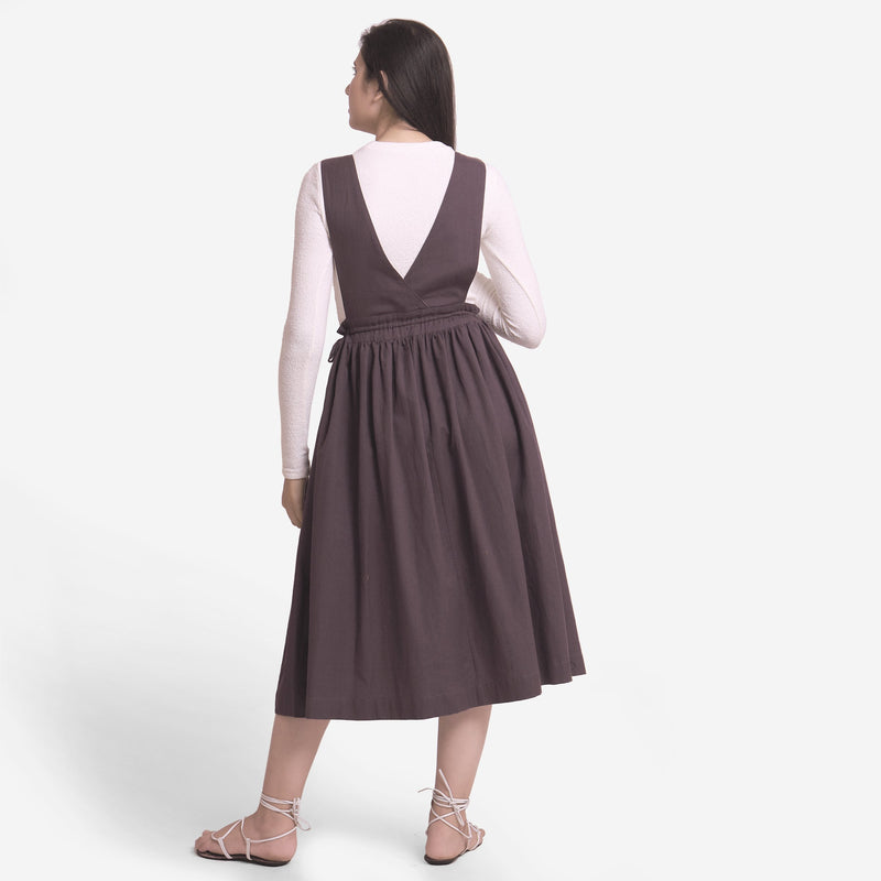 Back View of a Model wearing Brown Deep Neck Pinafore Midi Wrap Dress