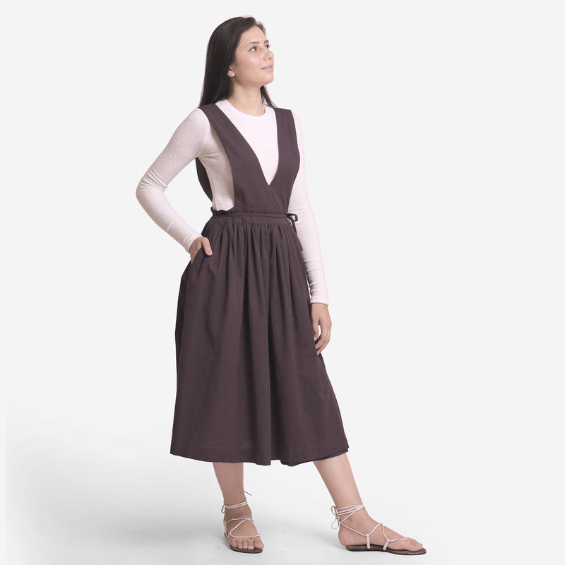 Right View of a Model wearing Brown Deep Neck Pinafore Midi Wrap Dress