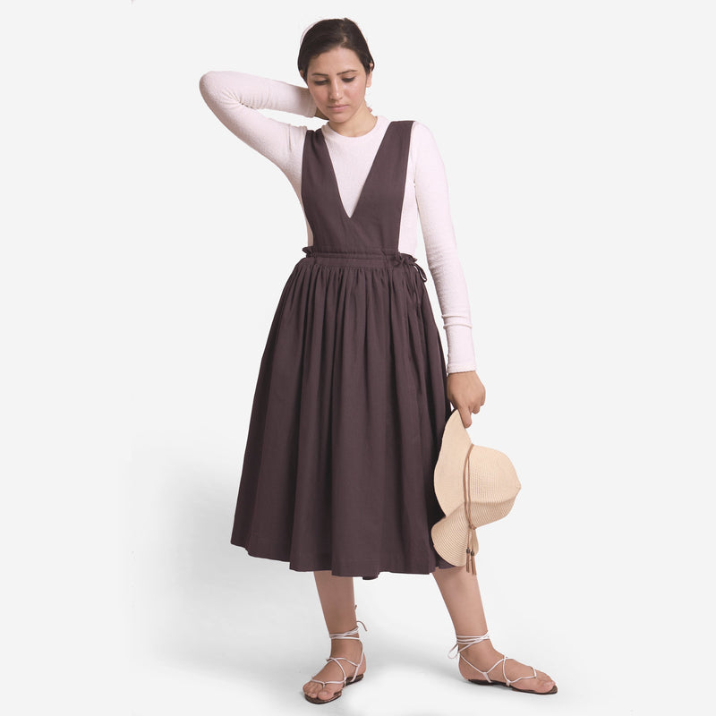 Front View of a Model wearing Brown Deep Neck Pinafore Midi Wrap Dress