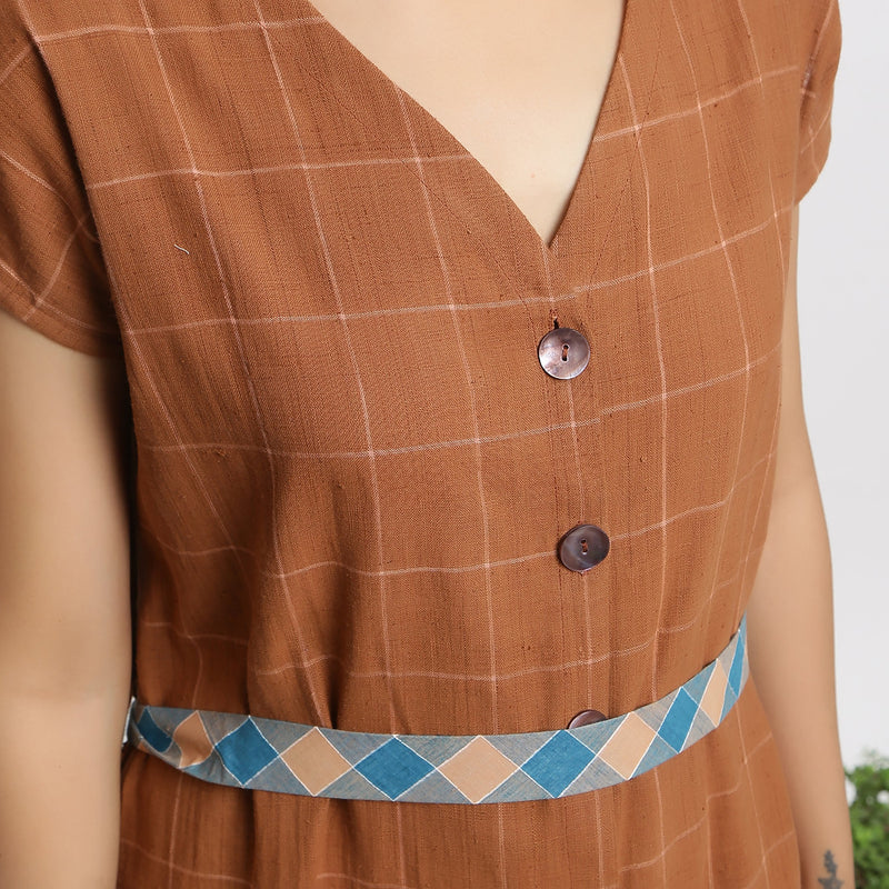 Front Detail of a Model wearing Brown Handspun V-Neck Shift Dress