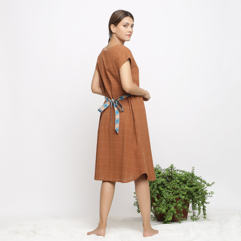 Back View of a Model wearing Brown Handspun V-Neck Shift Dress