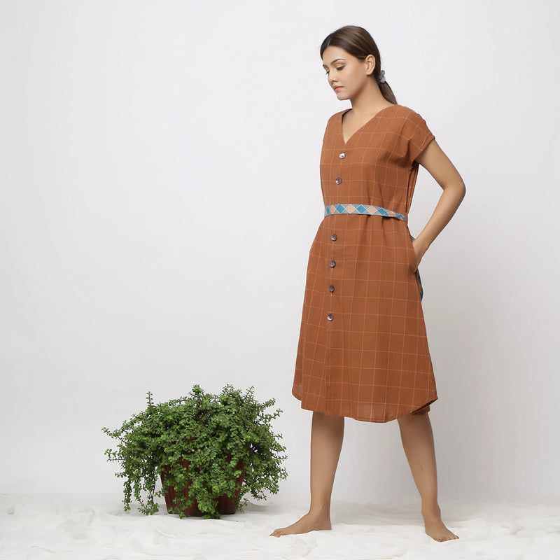 Left View of a Model wearing Brown Handspun V-Neck Shift Dress