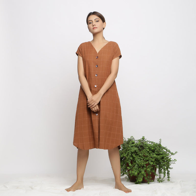 Front View of a Model wearing Brown Handspun V-Neck Shift Dress