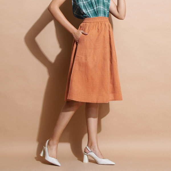 Right View of a Model wearing Brown Handspun Flared Knee Length Skirt