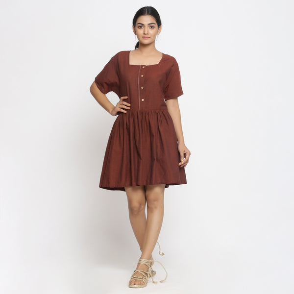 Front View of a Model wearing Brown Cotton Button-Down Gathered Dress