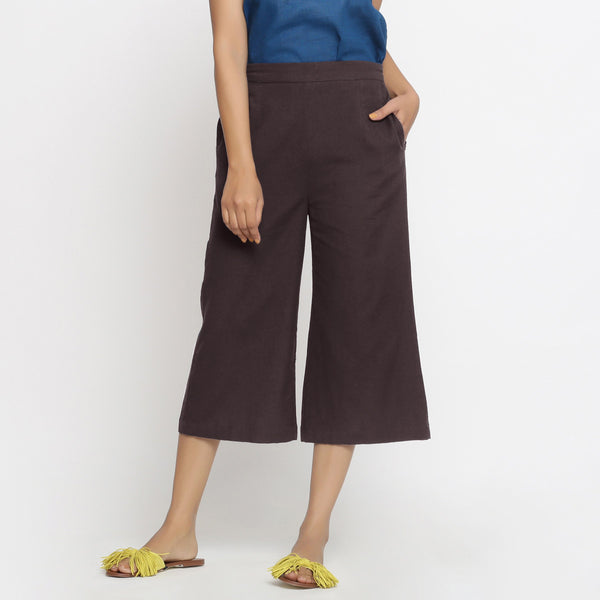 Front View of a Model wearing Brown Mid-Rise Cotton Flax Culottes