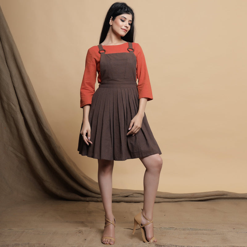 Front View of a Model wearing Brown Pleated Criss-Cross Back Dress