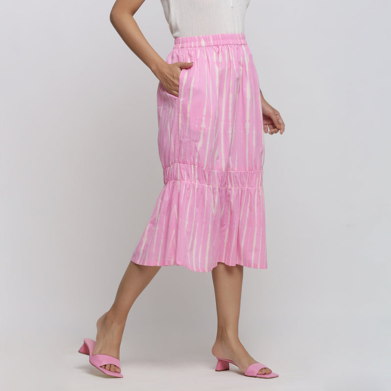 Right View of a Model wearing Bubblegum Pink Tie And Dye Balloon Skirt