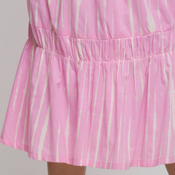 Close View of a Model wearing Bubblegum Pink Tie And Dye Balloon Skirt