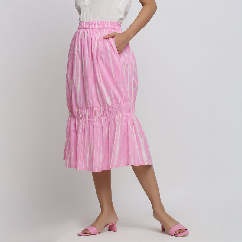 Left View of a Model wearing Bubblegum Pink Tie And Dye Balloon Skirt