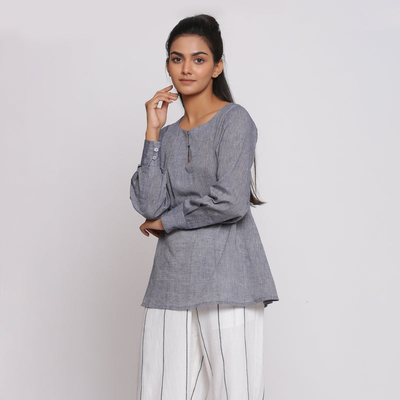 Left View of a Model wearing Charcoal Grey Cotton Flared Tunic Top