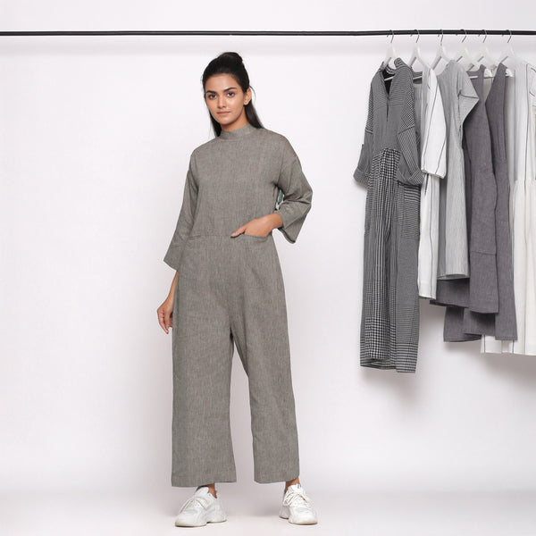 Front View of a Model wearing Charcoal Grey Handspun Straight Ankle Length Jumpsuit