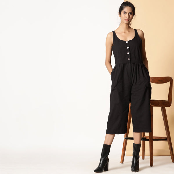 Front View of a Model wearing Chic Black Cotton Button-Down Jumpsuit