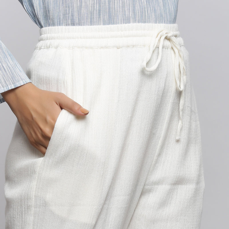 Front Detail of a Model wearing Off-White Crinkled Cotton Tapered Pant