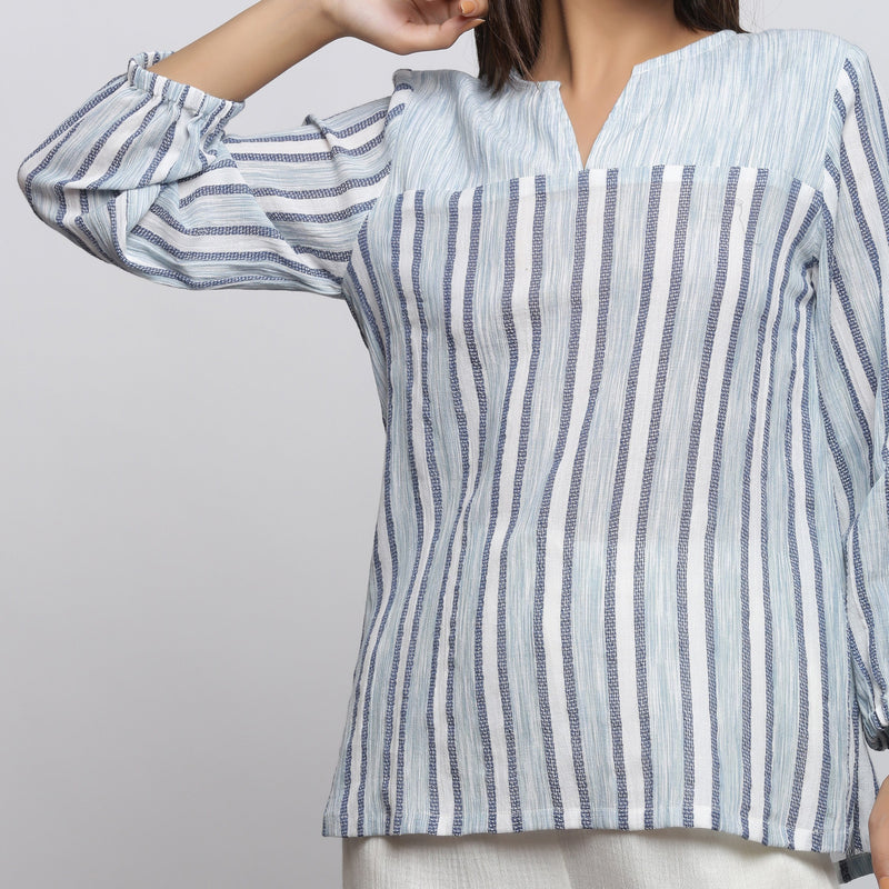 Front Detail of a Model wearing Off-White And Sky Blue A-Line Yoked Top