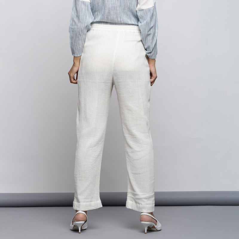 Back View of a Model wearing Off-White Crinkled Cotton Tapered Pant