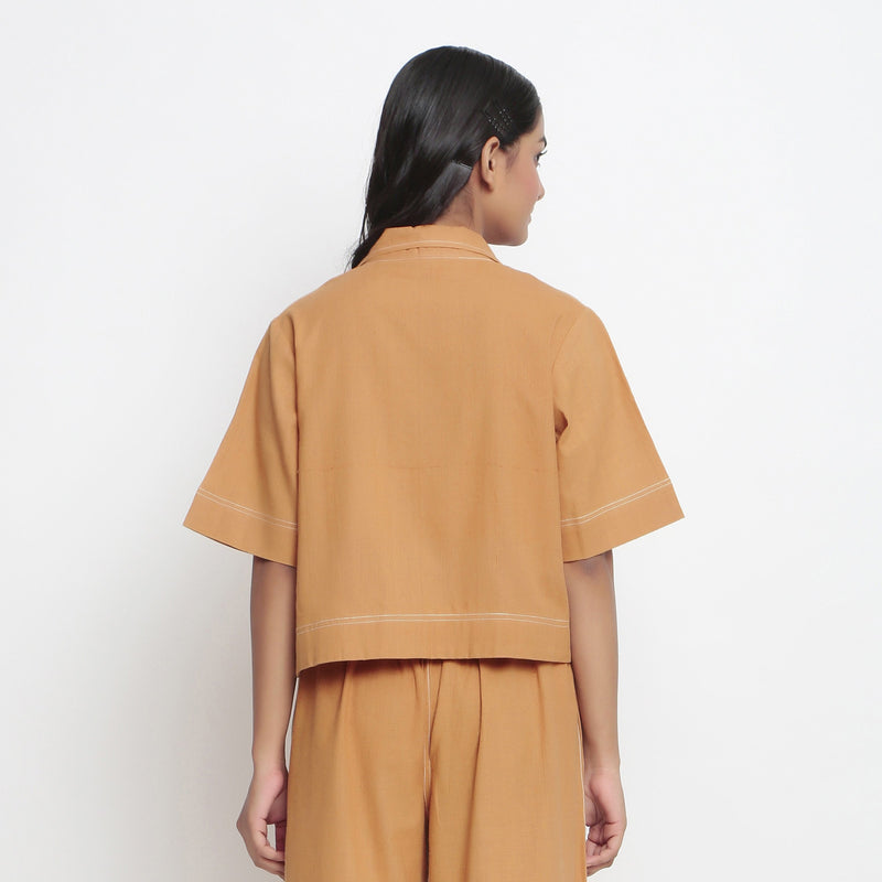 Back View of a Model Wearing Rust Vegetable Dyed Solid Handspun Shirt