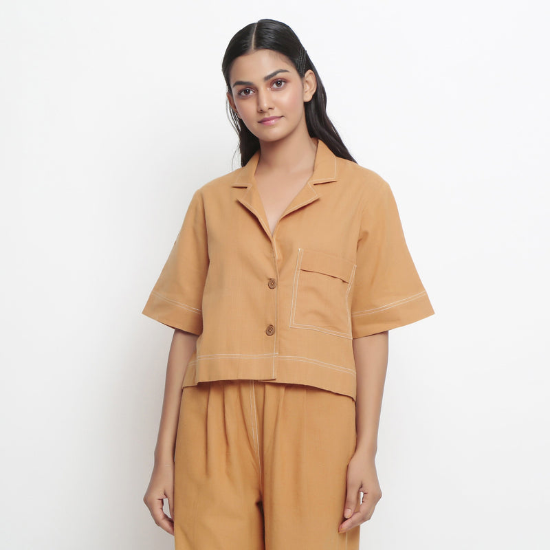 Front Detail of a Model wearing Vegetable Dyed Rust Top and Solid Pant Set