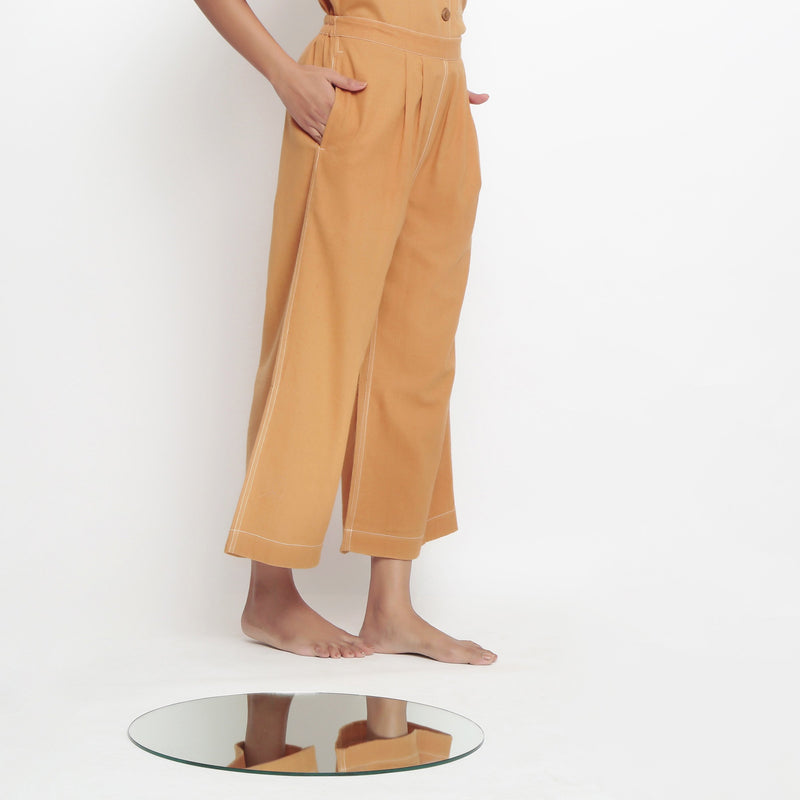 Right View of a Model wearing  Vegetable Dyed Rustic Wide Legged Pant