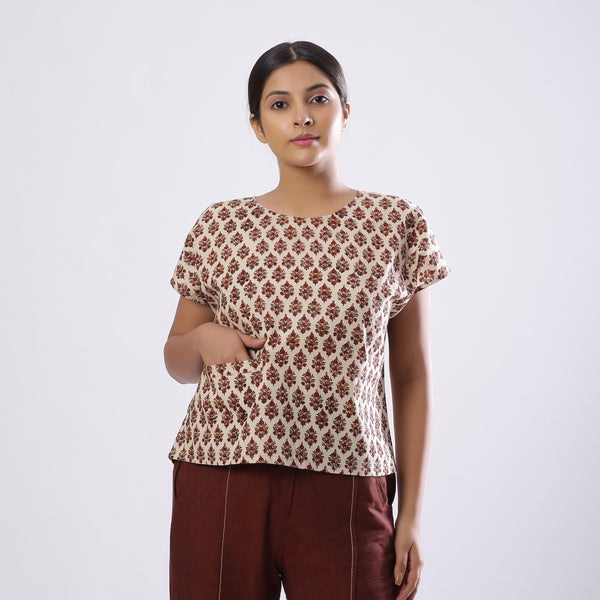 Front View of a Model wearing Beige Block Print Floral Loose Fit Top
