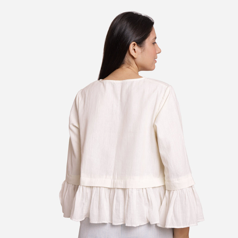 Back View of a Model wearing White Frilled Cotton Peplum Top