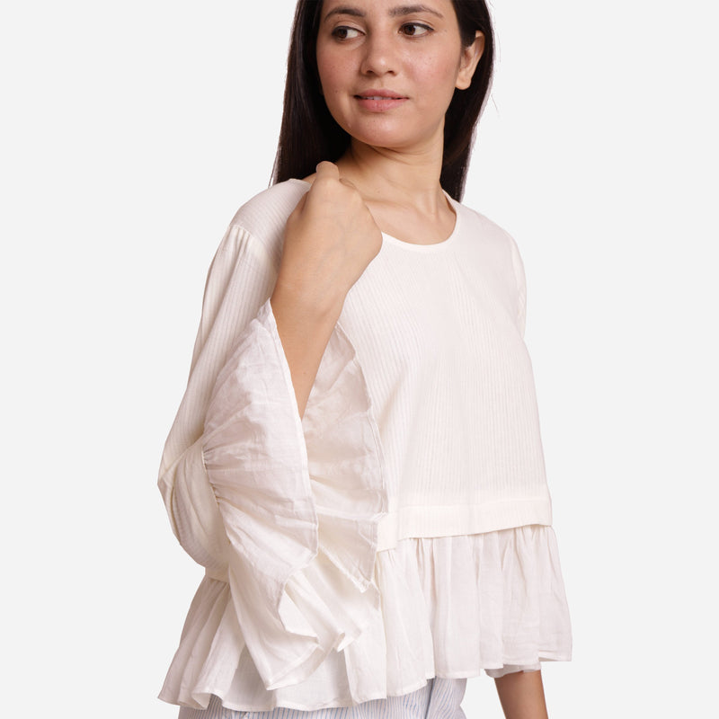 Right Detail of a Model wearing White Frilled Cotton Peplum Top