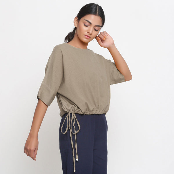 Right View of a Model wearing Solid Beige Cotton Flax Blouson Top