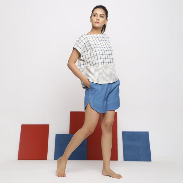 Right View of a Model wearing Blue Vegetable Dyed Top and Shorts Set