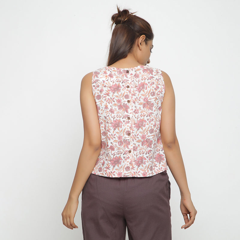 Back View of a Model wearing White Floral Printed Sleeveless Top