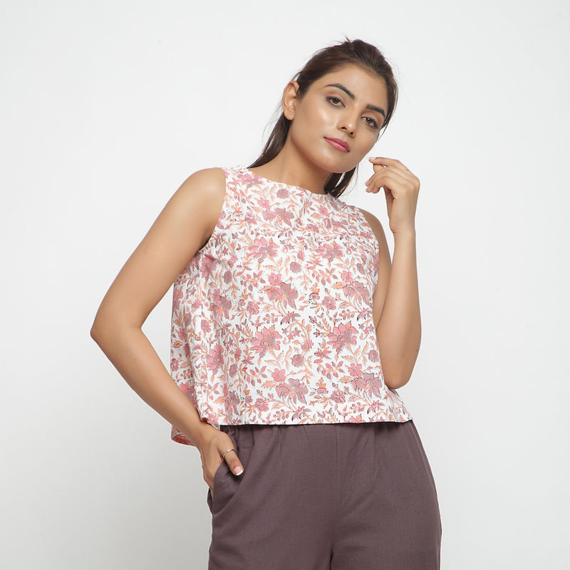Front View of a Model wearing White Floral Printed Sleeveless Top