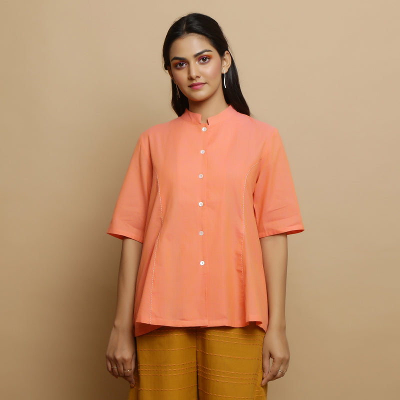 Front View of a Model wearing Handwoven Cotton Godet Button-Down Top