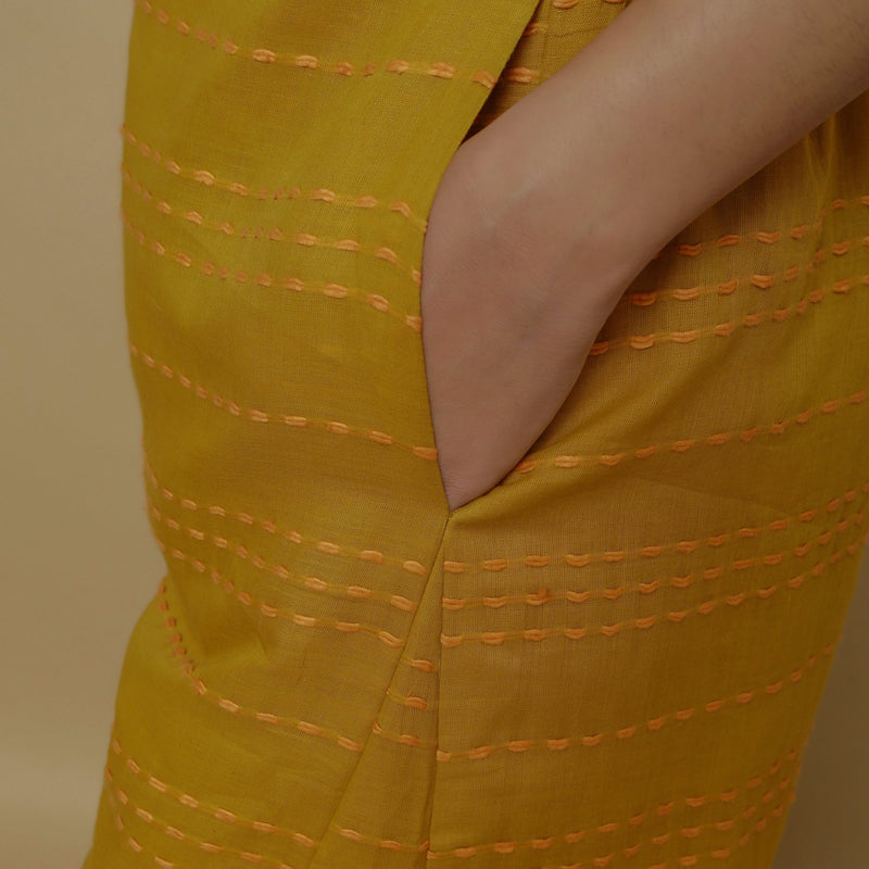 Close View of a Model wearing Mustard Paneled Striped Handwoven Pant