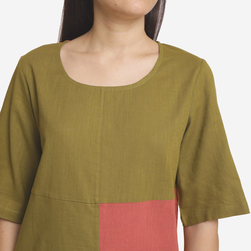 Front Detail of a Model wearing Khaki Green and Brick Red Relaxed Fit Top