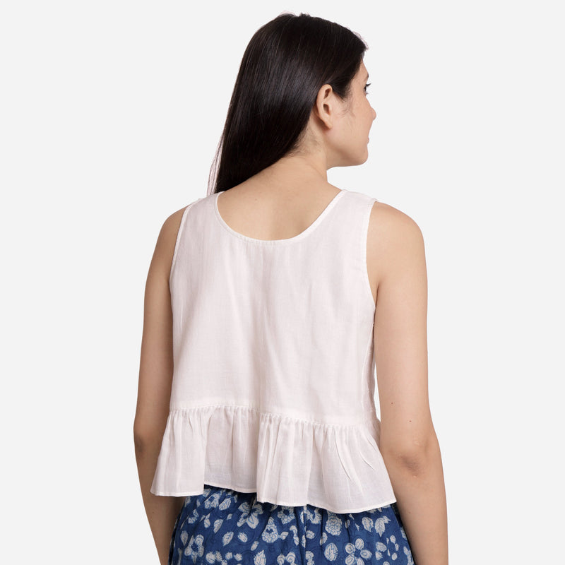 Back View of a Model wearing White Round Neck Cotton Peplum Top