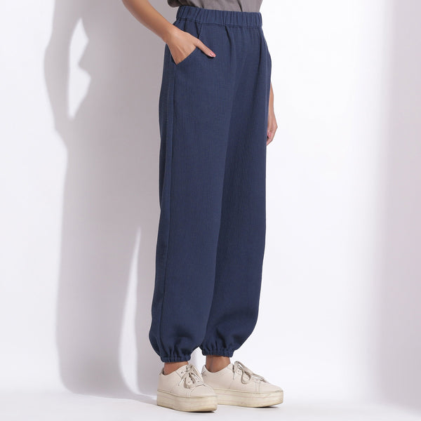Left View of a Model wearing Comfy Navy Blue Cotton Waffle Jogger Pant
