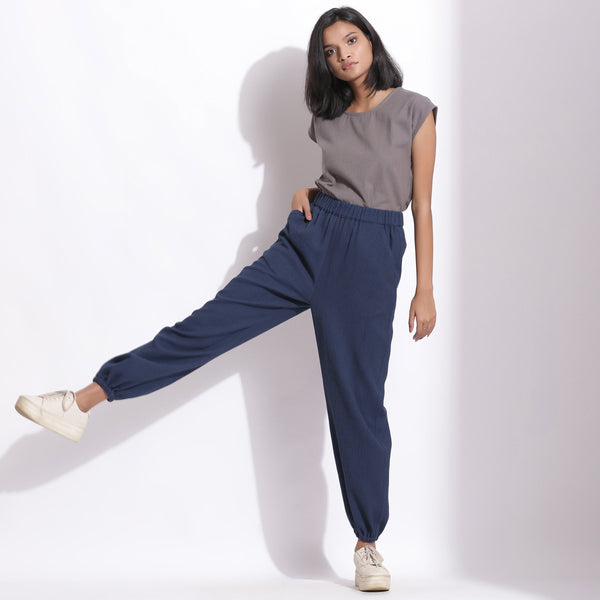 Front View of a Model wearing Comfy Navy Blue Cotton Waffle Jogger Pant