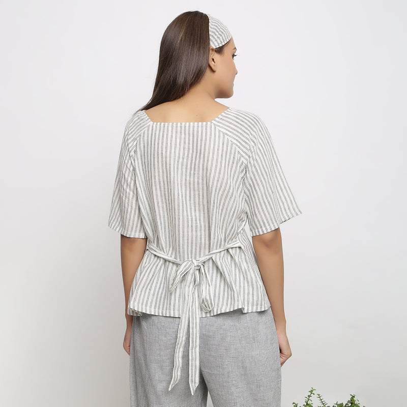 Back View of a Model Wearing Handspun Striped Top and Checkered Pant Set