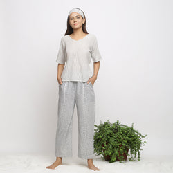 Front View of a Model Wearing Handspun Striped Top and Checkered Pant Set