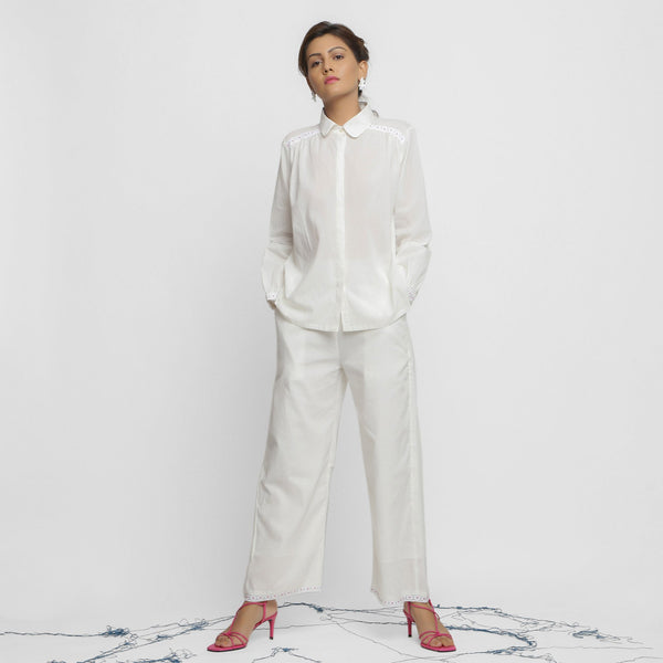 Front View of a Model wearing Crisp White Organic Cotton Top and Pant Set