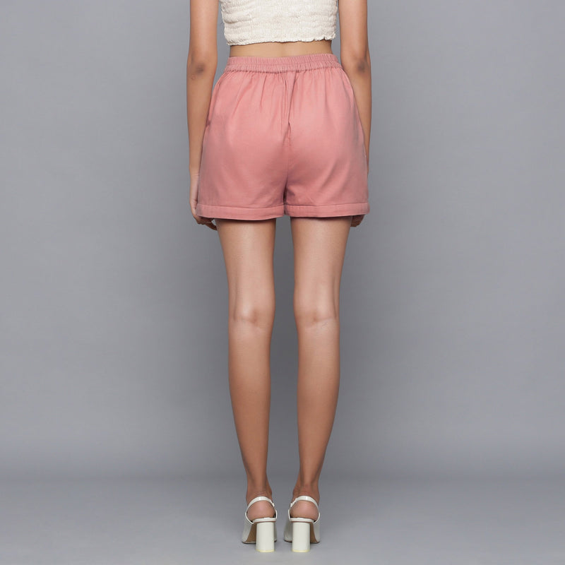Back View of a Model wearing Pink Flannel Convertible Pant Shorts