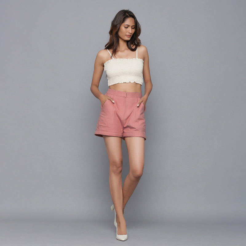 Front View of a Model wearing Pink Flannel Convertible Pant Shorts