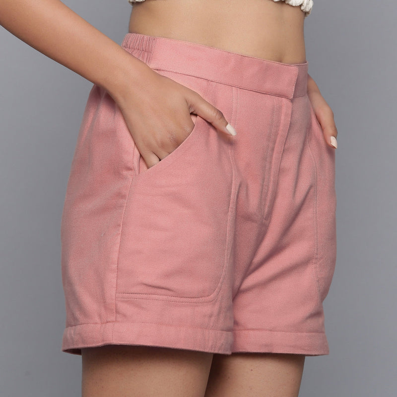 Right View of a Model wearing Pink Flannel Convertible Pant Shorts