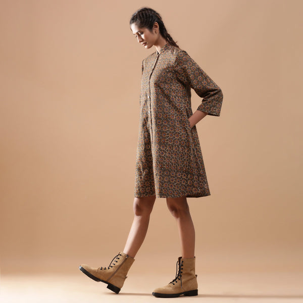 Left View of a Model wearing Convertible Warm Kalamkari Button-Down Overlay Dress