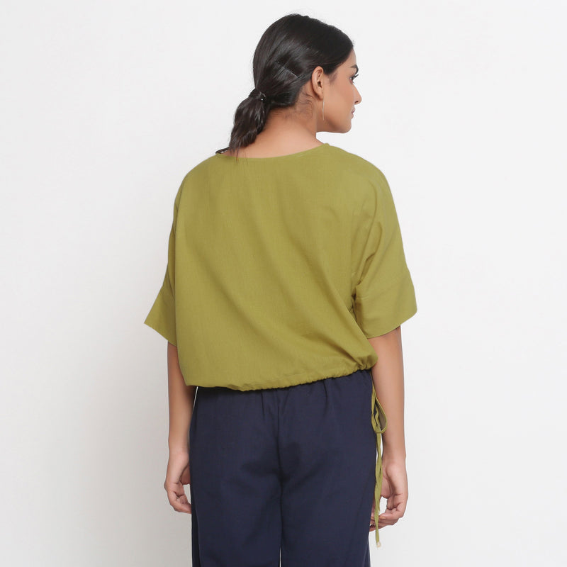 Back View of a Model wearing Solid Green Cotton Flax Blouson Top